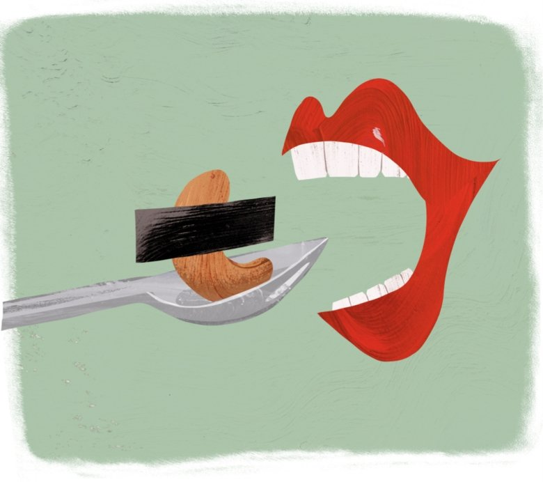 Illustration of mouth eating a peanut.