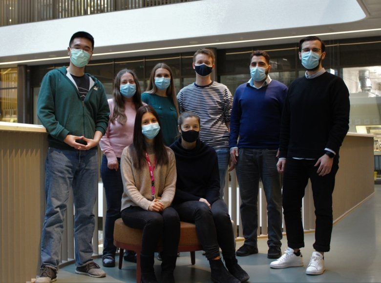 Kirsty Spalding's group with face masks posing togheter for the group picture.
